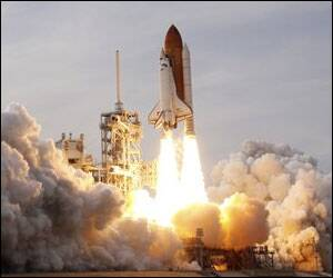 Shuttle soars to space station after launch delays