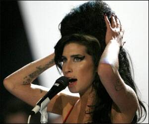 Amy Winehouse's new boyfriend is a 'gift for god ...