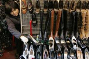 Women purchase 469 pairs of shoes through life: Survey