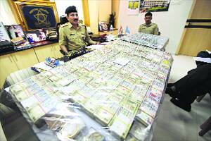 M_Id_178303_The_seized_cash_and_gold_