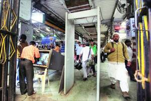 M_Id_224508_Metal_detectors_being_repaired_at_CST_station_four_days_after_the_serial_blasts