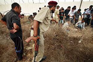 Mass grave of prisoners found in Tripoli: NTC