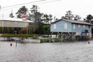 Isaac waters top Louisiana levee,homes flooded