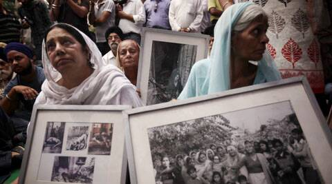Relatives of the victims of the 1984 riots protest in Delhi.