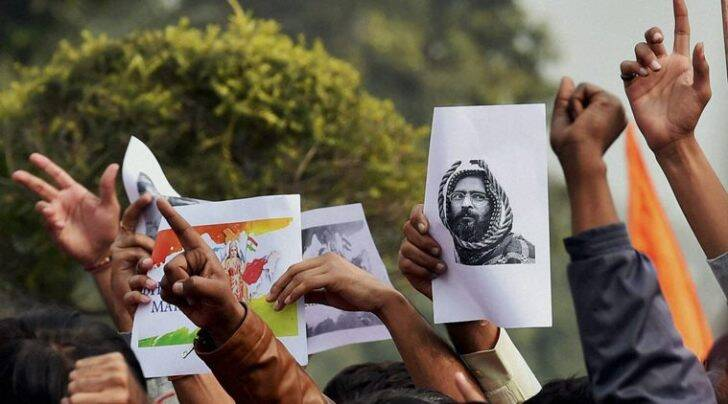 ABVP activists protest against an event at JNU supporting Parliament attack convict Afzal Guru in New Delhi on Friday. (PTI Photo by Kamal Singh)