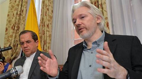 """Ecuador's Foreign Minister Ricardo Patino, left, and WikiLeaks founder Julian Assange speak during a press conference inside the Ecuadorian Embassy in London, where he confirmed he """"will be leaving the embassy soon. Source: AP photo"""