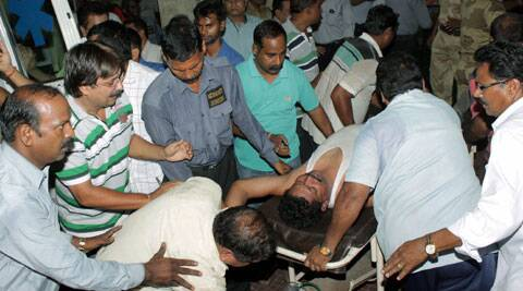 An injured being taken to the hospital, where gas leakage victims are treated, in Bhilai on Friday. (Source: PTI)