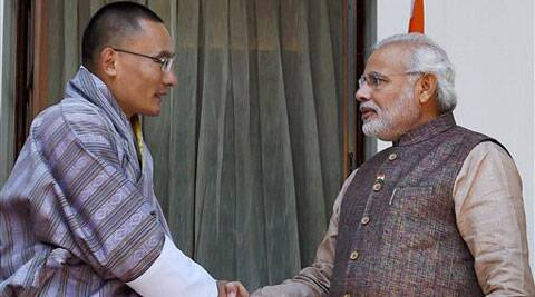 Prime Minister Narendra Modi shake hands with his Bhutan counterpart Lyonchhen Tshering Tobgay during a meeting at Hyderabad House in New Delhi on Tuesday. (Source: PTI)