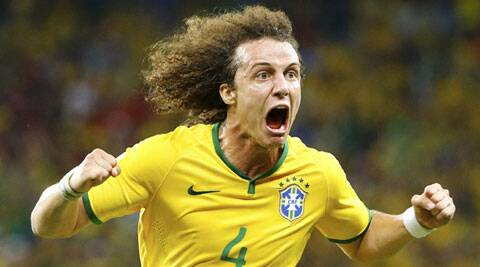 Brazil's David Luiz celebrates after scoring a goal against Colombia (Source: Reuters)