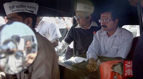 Aam Admi Party (AAP) chief Arvind Kejriwal campaigning for the upcoming Lok Sabha polls, in an auto rickshaw, in Mumbai.