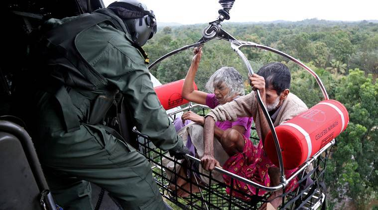 People are airlifted by the Navy personnel during a rescue operation at a flooded area in the southern state of Kerala. (Reuters)