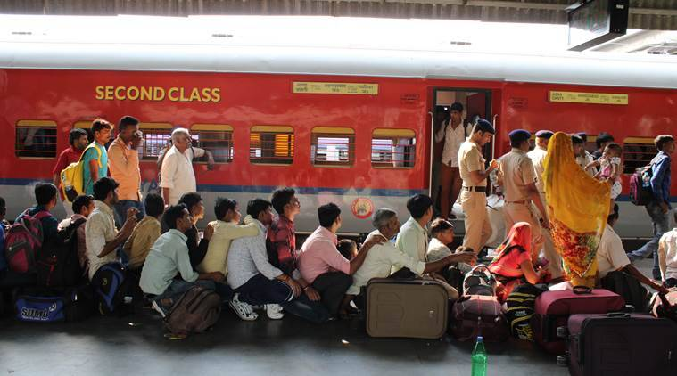 Amid yoga, TV and chai, group at Varanasi station asks: Will trains take us home?