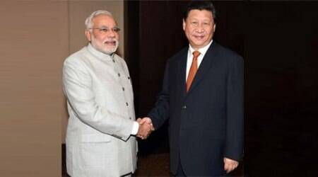 Prime Minister Narendra Modi with President of China Xi Jinping during the bilateral meeting in Fortaleza in Brazil on Monday.  (Source: PTI)