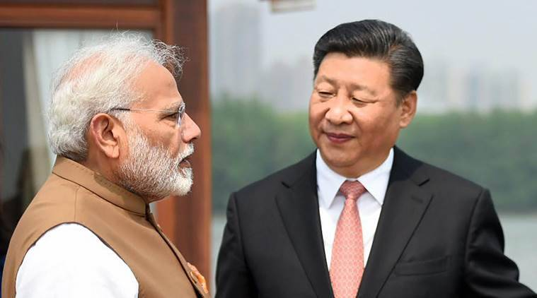 China says won't force India to accept Belt and Road