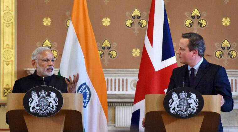 Narendra Modi, David Cameron, Modi in UK, Modi UK visit, Modi UK photos, Modi visits UK, Modi London protest, Modi Cameron, Modi 10 downing street, modi david, modi united kingdom, India UK relationship, Modi UK pictures, World news