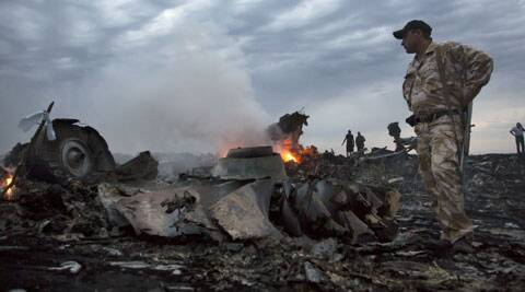 Smoke rises from debris at the crash site near the village of Grabovo in Ukraine, Thursday. (Source: AP)