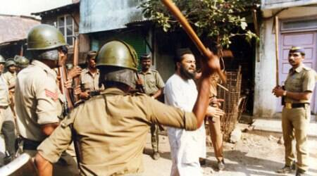 Police Personnels beat a muslim man during the Mumbai riots of 93 at Gowandi. (Source: Express Photo by Mukesh Parpiani)