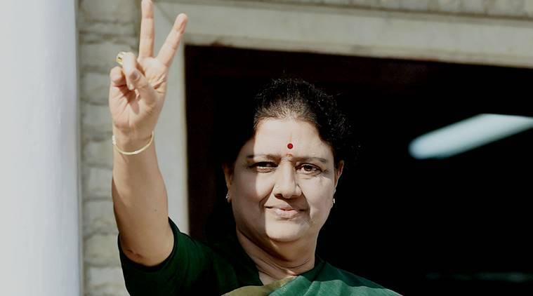Chennai: AIADMK General Secretary V K Sasikala flashes a victory sign after attending the party MLA's meeting in which she was elected as a AIADMK Legislative party leader, set to become Tamil Nadu CM, at Party's Headquarters in Chennai on Sunday. PTI Photo by R Senthil Kumar (PTI2_5_2017_000121a)