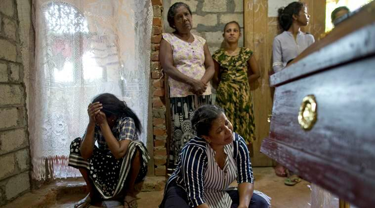 The family of 12-year Sneha Savindi, killed in the Easter Sunday bombing, in Negombo, Sri Lanka. (AP)
