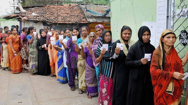 Coimbatore: Women standing in queue to cast their vote during assembly elections in Coimbatore on Monday. PTI Photo (PTI5_16_2016_000060B)