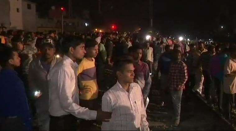 Dozens feared dead as train runs over crowd in India