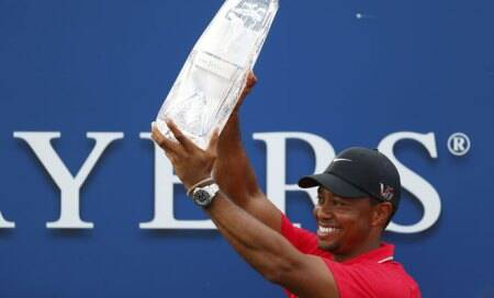Tiger Woods holds on to win Players Championship