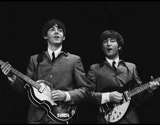 This file photo of February 11,1964,provided by Christie's auction house from a collection of photos of The Beatles shot by photographer Mike Mitchell,shows Paul McCartney and John Lennon during their first U.S. concert,at the Washington Coliseum in Washington,D.C. in 1964. AP