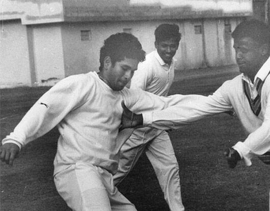 Sachin Tendulkar and Vinod Kambli playing football during a practice session at Palam Air Force ground. (IE Photo)