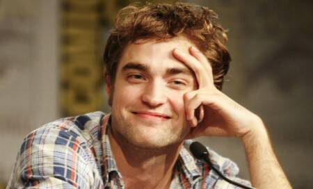 Robert Pattinson parties with 'Fifty Shades'author