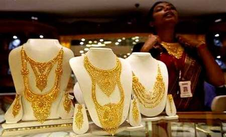 Gold price inches up on thin trade as stocks ease