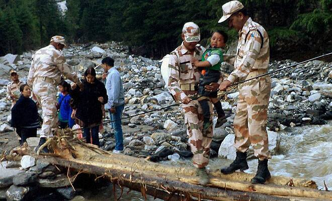 M_Id_403349_ITBP_personnel_rescuing_flood_victims_near_Gangotri_in_Uttarakhand.