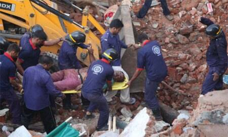 11 killed,40 feared trapped in Vadodara twin building collapse; Modi orders probe