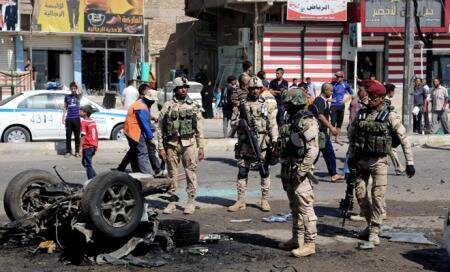 65 killed and scores injured in Iraq bomb attacks