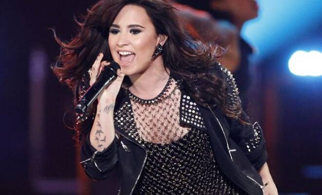 Demi Lovato feels she has had an easier time growing up in limelight.
