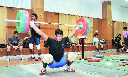 In 16-yr-old's weightlifting gold,a lift for 'criminal village'