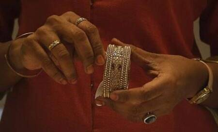 Gold imports to come down sharply to $38 bn in FY14:Rangarajan