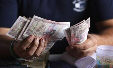 Indian rupee falls sharply to near 63.50 per US dollar ahead of Fed meet