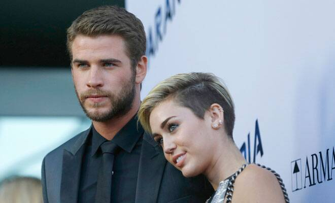 M_Id_420772_miley-cyrus-liam-hemsworth-1