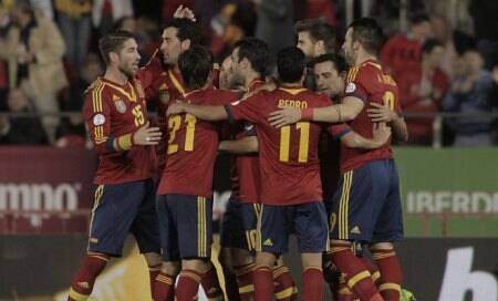 Spain on brink after scraping past cautious Belarus