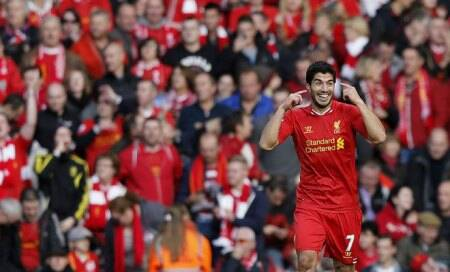 Luis Suarez hat-trick keeps Liverpool on Arsenal's tail