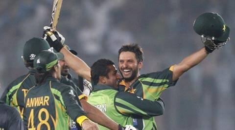 Shahid Afridi celebrates after hitting the winning six against India on Sunday. Afridi scored 34 (not out) (Reuters)