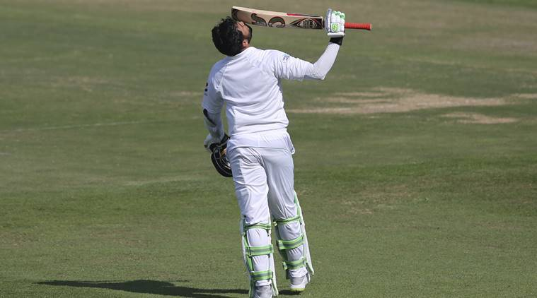 Azhar Ali kisses his bat after scoring his 15th Test ton.