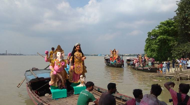 Durga Puja 2017: For 8 decades, this Belur club has been transporting idols via the river in a unique way
