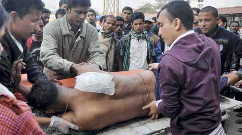 An injured police person brought to the Guwahati Medical College Hospital (GMCH) for treatment. (PTI photo)