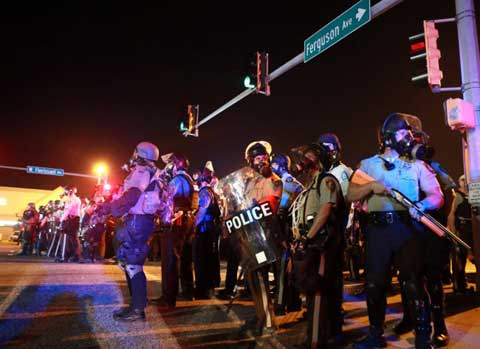 Ferguson's rage: Protesters return to riot-scarred streets on Tuesday