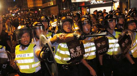 Hong Kong democracy street battles rage on despite imminent talks