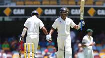 Vijay, Rahane anchor India to 311/4