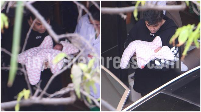 As Karan Johar takes his babies Yash and Roohi home, here are their adorable first pics