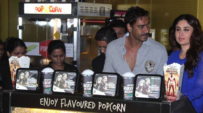 Kareena, Ajay, Rohit turn popcorn vendors for 'Singham Returns'