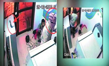 Beaten,tied,ATM guard foils theft bid; honoured by cops